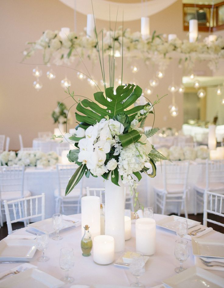 Mostly White Wedding Decor | Centerpiece On SMP: http://www.stylemepretty.com/north-carolina-weddings/2013/11/27/north-carolina-arboretum-wedding-from-bamber-photography | Bamber Photography