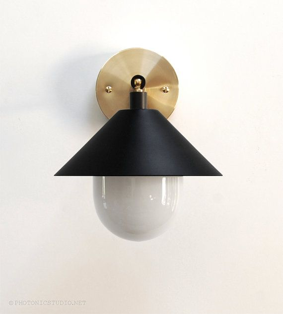 Introducing the UFO sconce, a Photonic Studio original. • Modern wall light • Opal glass diffuser • Cone shade finished in matte black • Solid