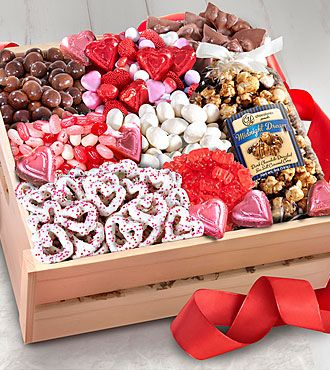 The Sweet Them Off Their Feet Valentine's Gourmet Basket will make this Valentine's Day full of fun and gourmet goodness for your loved ones, friends and family! Arriving in a natural seagrass basket are the following treats, including: 6 oz. Caramel Hearts, 6 oz. Chocolate Covered Dried Bing Cherries, 6 oz. Jelly Belly Valentine Deluxe Mix Candy Assortment, 3 Ghirardelli® Caramel Chocolate Squares, 3 Ghirardelli® Dark Chocolate Squares with Raspberry Filling, 6 oz. Chocolate Almond Ba