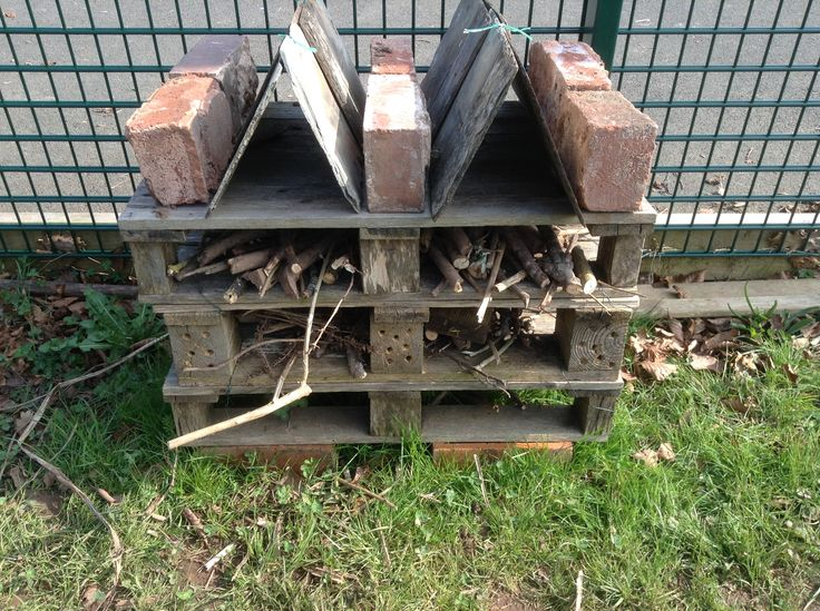 Child built bug hotel using natural materials and recycled pallets,bricks, slates.