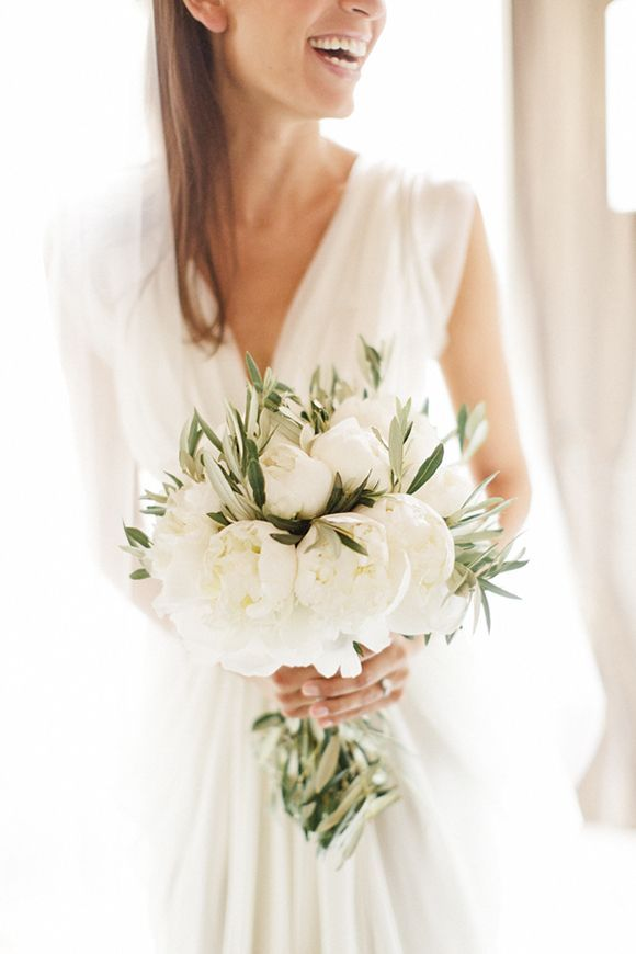 All white and oh-so-elegant, white peony and olive branch bouquet by Blandine Viry