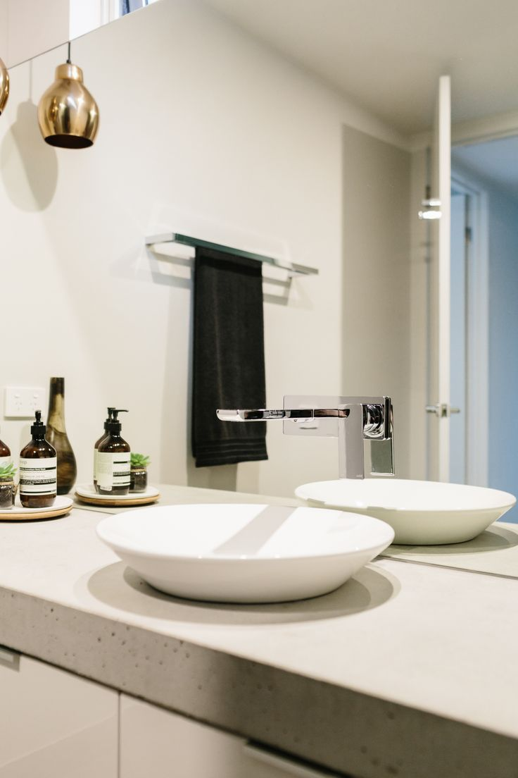 Concrete benchtops in the guest bathroom.... The Murnane Residence a GD&C project Photo by Tara Pearce, Styling by Stephanie Somebody