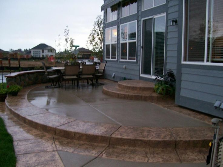 regular concrete patio with stamped colored border