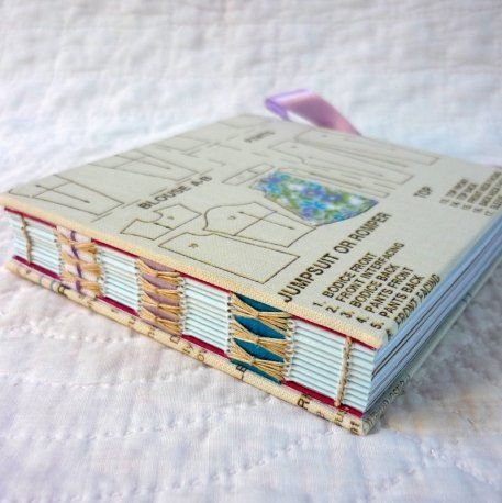 Kate Bowles hand-bound notebooks and journals using recycled papers and fabrics, with a particular emphasis on revealing the sewing on the book spine.