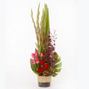 Jewel toned flowers in ceramic pot