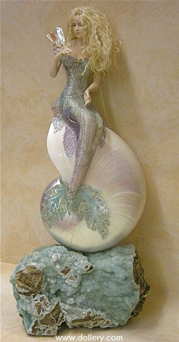 I love my fairies made by Susan Snodgrass. I think this mermaid is pretty special, too.