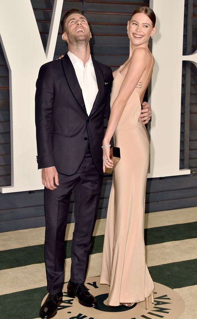 Adam Levine & Behati Prinsloo from 2015 Oscars After-Party Looks (Plus Viewing Parties!)  In a tuxedo (Adam) and Calvin Klein (Behati).