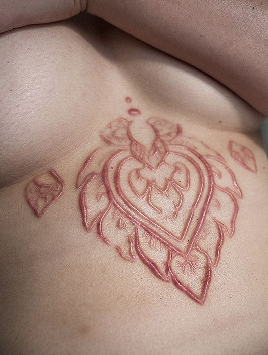 Not a tattoo but looks awesome; scarification | I've always been interested in scarification....