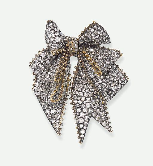 Antique tied ribbon brooch set with rose-cut diamonds.