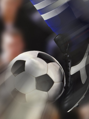 Close-up of a Soccer Player Kicking a Soccer Ball Photographic Print at Art.com