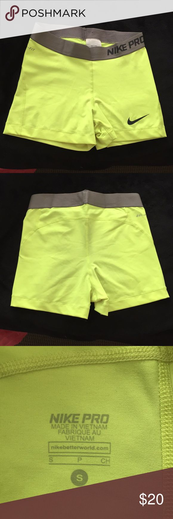 Nike Pro shorts Neon yellow Nike Pro spandex, worn once, good condition, slight pilling on the inside of the waistband Nike Shorts