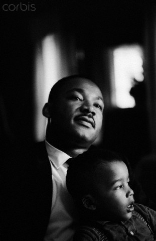 Martin Luther King Jr. holds his son Dexter on his lap at home.  November 08, 1964
