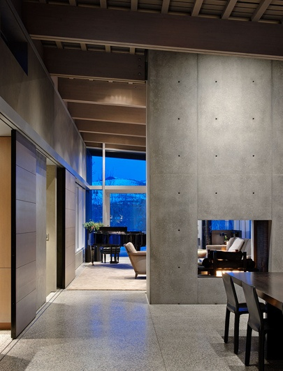 Concrete walls, fire place divider, timber sliding doors, timber lined ceiling