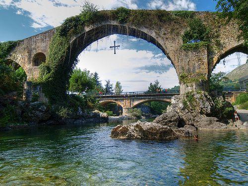 Cangas de Onis, Asturias, Spain (by palmeraimperial).  Notice the cross hanging underneath the bridge.