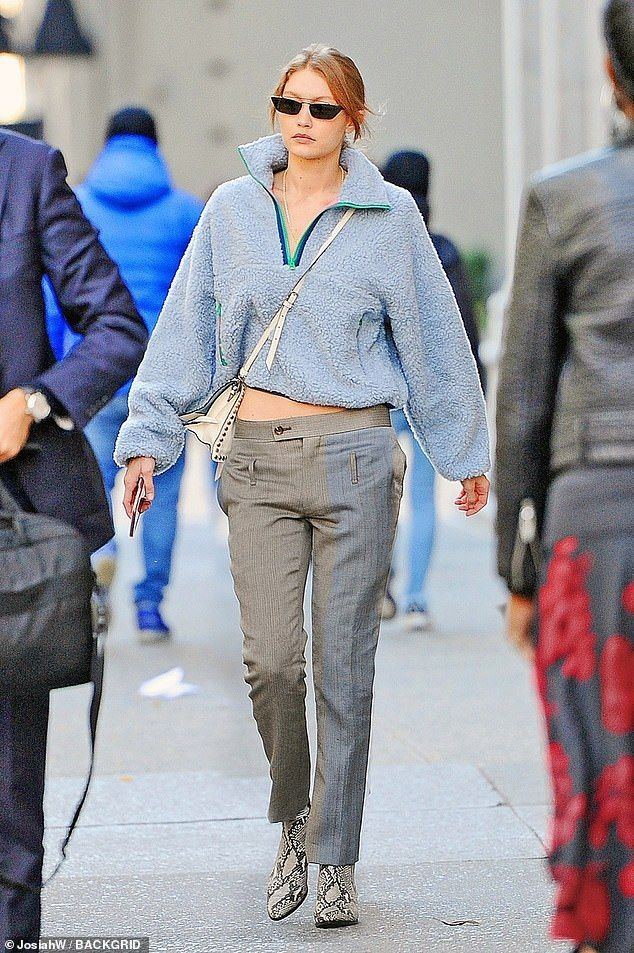 1d76c6bd77b Gigi Hadid dons a cozy fleece and snakeskin boots while out in NYC