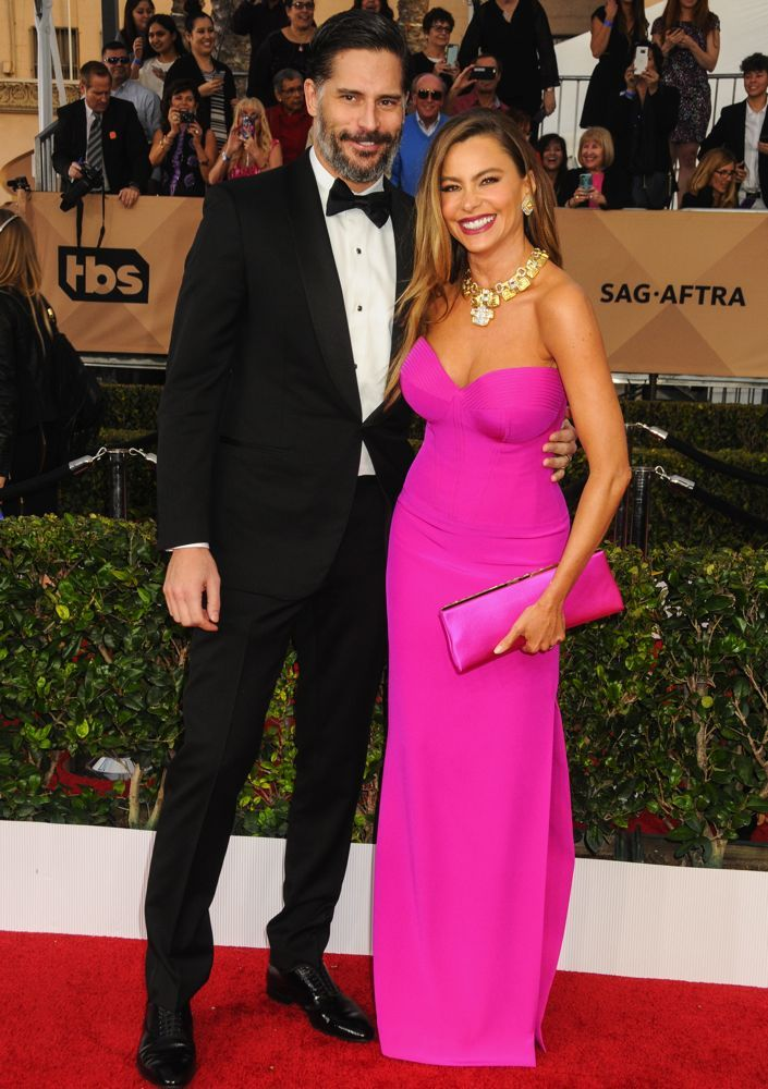 2016 SAG Awards - Joe Manganiello and his wife Sofia Vergara looked great. The newlyweds dressed to the nines for the ceremony. Joe suited up in Ermenegildo Zegna, while Sofia sported a fuchsia Vera Wang strapless gown accented by a matching Jimmy Choo clutch and David Webb jewelry.