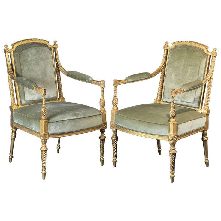 Pair of George III giltwood armchairs.