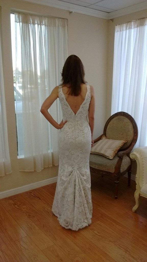Stunning form fitting designer gown by Alvina Valenta made with romantic ivory European Lace.Train with hook for bustle to wear during reception.