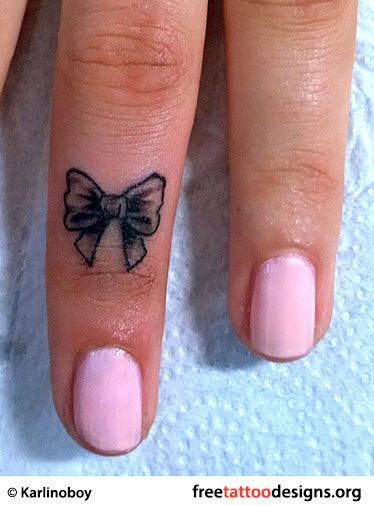 Small bow tattoo on a girl's finger