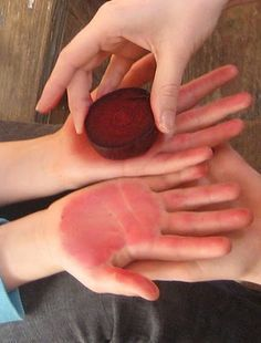 Rite of Passage, menarche ceremony. Staining hands red with beetroot.
