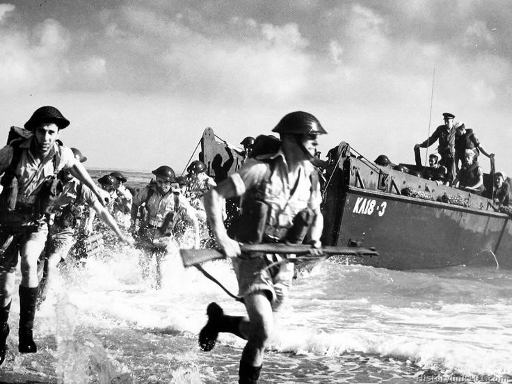 World War II in Pictures — British Marines preparing for the D-Day in North...