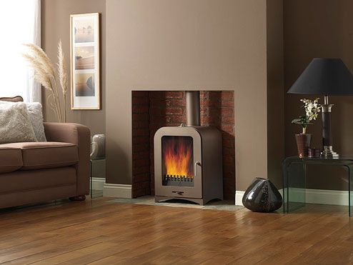 Wood burner - skirting board, slate surround and wooden flooring - all level....neat
