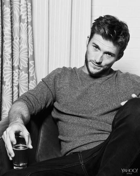 Scott Eastwood tosses a smoldering look a la his father Clint, in Tomas Maier Cashmere and Frame Denim Jeans.
