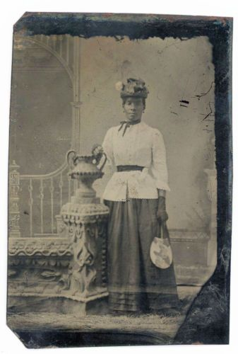 BLACK-AFRICAN-AMERICAN-WOMAN-WITH-TINY-WAIST-HOLDS-FAN-TINTYPE