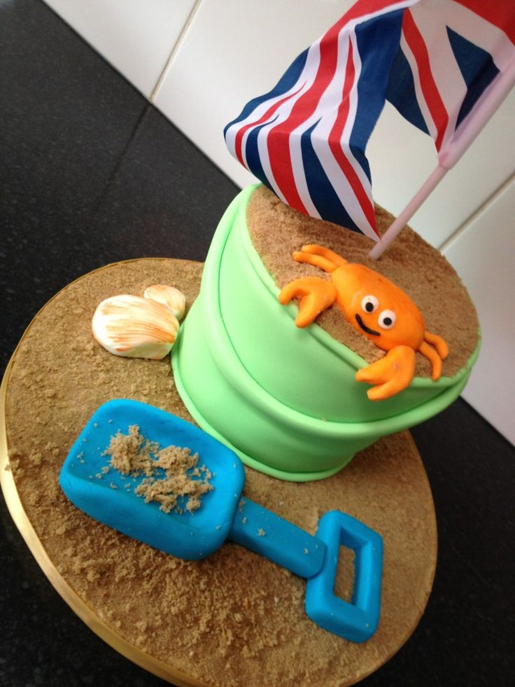 Summer sand bucket cake. A fun cake for a July or August Summer birthday party!