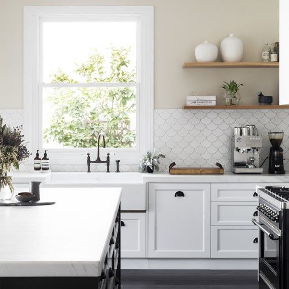 White kitchen design with scalloped tile and open shelving | GIA Renovations