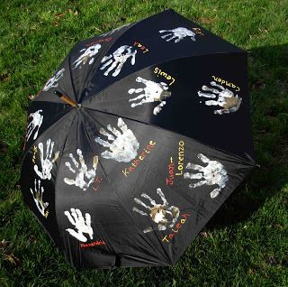 Cute, I love this! How fun to have an umbrella with my student's handprints.
