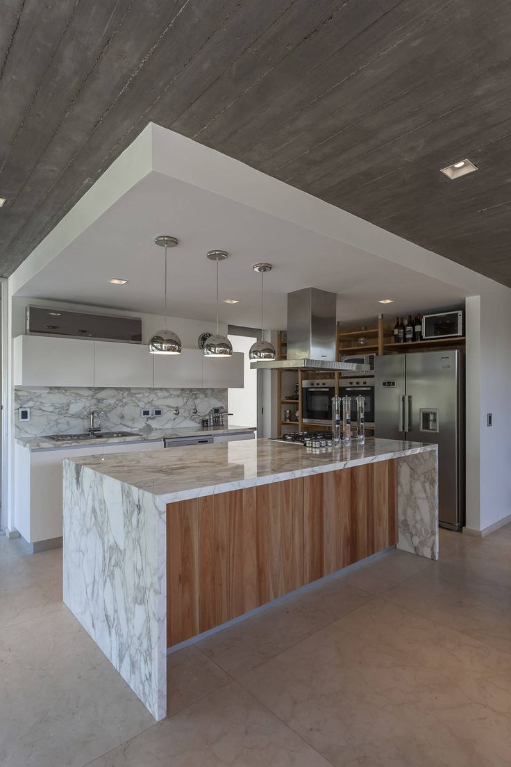 kitchen is defined with a totally different ceiling look
