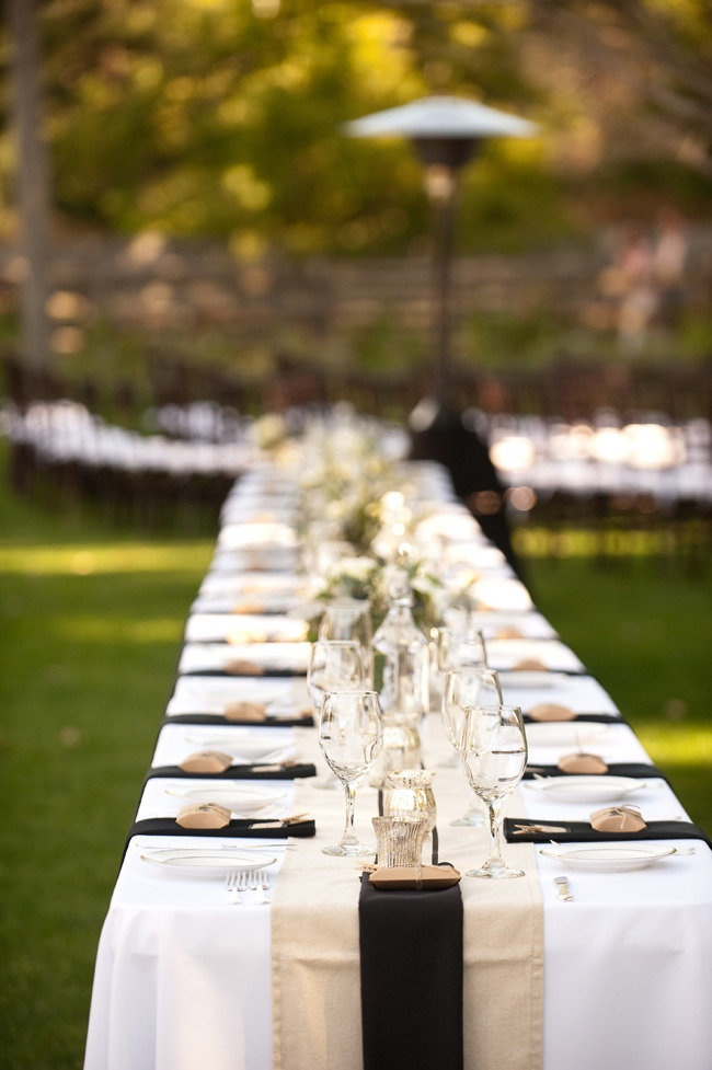 Black,cream and white for a backyard engagement party. Love how effective the black napkins are!