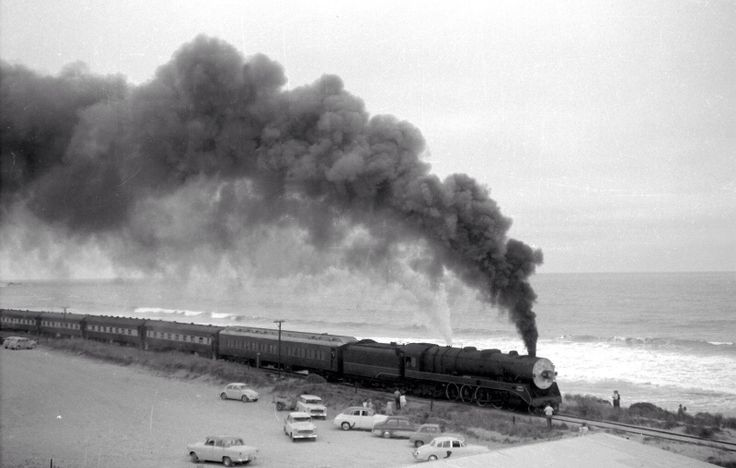 500 Class 4 8 2 broad gauge loco ambles past photographers with the Southern Ocean in the background, South Australia