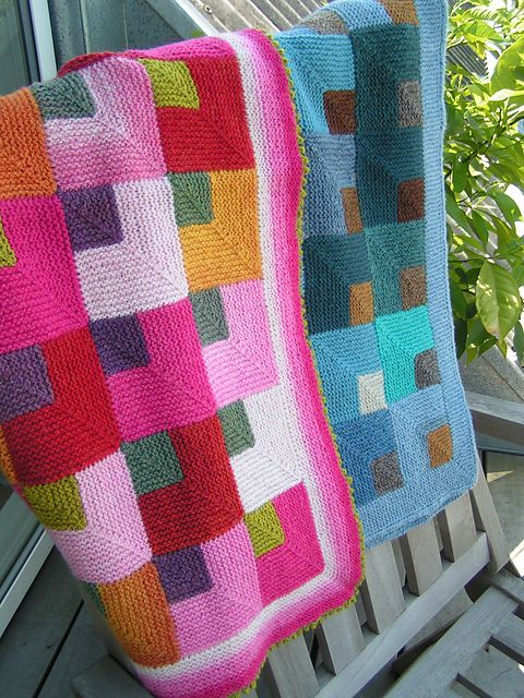 Knitted miter-square blankets done in Kauni.  Great use of sport weight yarn!