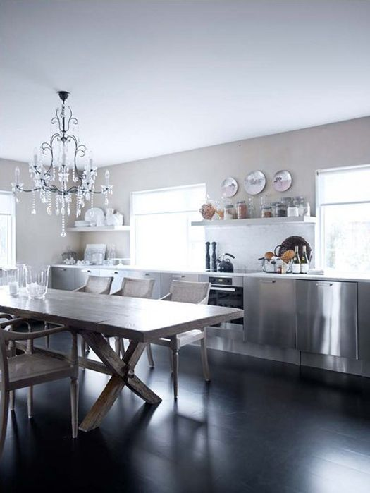 desire to inspire - desiretoinspire.net - Rut Karadottir  Stainless kitchen with rustic harvest table and delicate chandelier