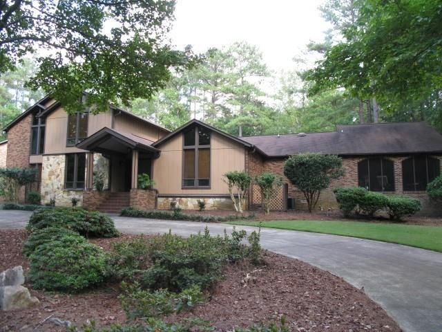 N. Macon gem nestled in the trees on 8 acres. Kitchen has polished granite countertops w custom waterfall edges double Jenn-Air ovens heating lamps and sprinkler system. Master ensuite includes 2 separate baths 2 oversized walk-in closets built-ins and a private screened porch. Gorgeous sunroom overlooks gunite pool picturesque garden areas and a brick covered porch. Bonusgame room with patio overlooking pool. 3-car garage. Huge laundry room. 1100 sq. ft. space above garage with electricity…