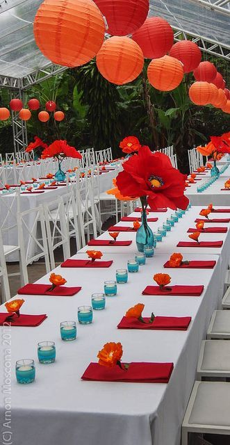 Paper flower tropical wedding. White table cloth, red napkin, turquiose accent and center is 1 big dramatic flower!