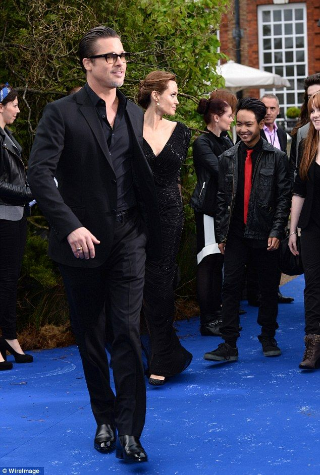 Special guest: Maddox Jolie-Pitt accompanied his parents Brad Pitt and Angelina Jolie to a private reception of Maleficent on Thursday at Kensington Palace