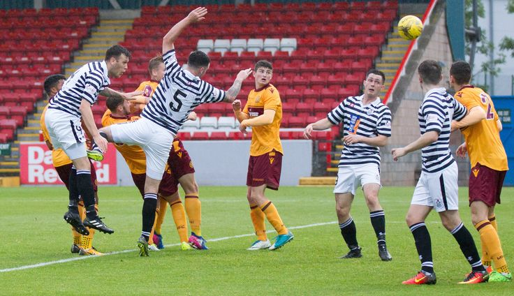 Queen's Park's Adam Cummins heads for goal during the IRN-BRU Cup Round 1 game between Motherwell 20s and Queen's Park