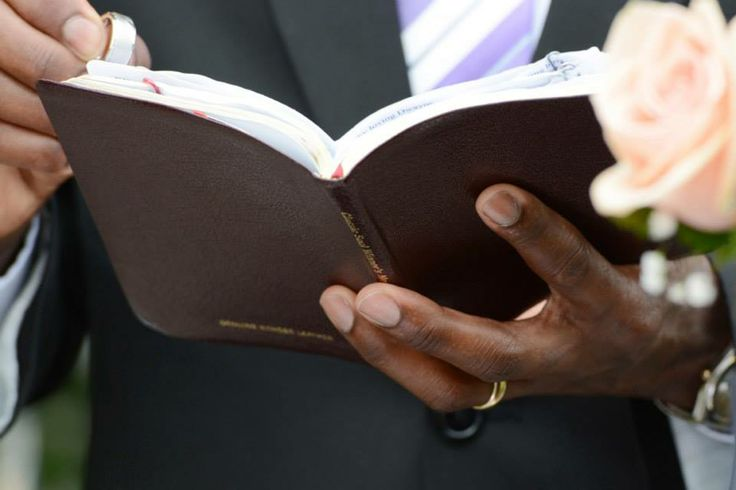 Close up of the pastor's Bible wedding photo