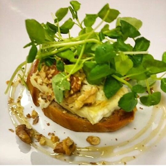 Bread, chevre d' argental, honey roasted walnut and water cress. LoWe