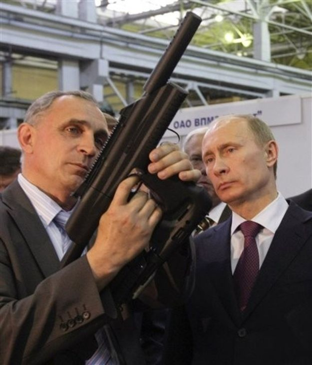 Vladimir admires Russian assault rifle engineering.