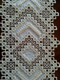 hardanger note the braided like stitch around the center medallion