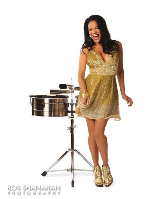 Sheila E. in a Gold Shimmer Dress