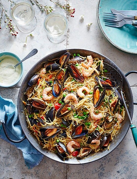 Seafood fideuà  Fideuà is a Spanish dish similar to paella that uses short strands of pasta instead of rice. If you can't find fideuà, break angel hair pasta into short pieces.