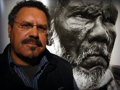 "Tasmanian Aboriginal photographer, Ricky Maynard with an image from his series ""Portraits of a Distant Land""."