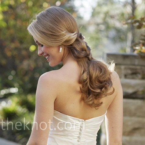 A tucked and twisted ponytail is soft but still special.