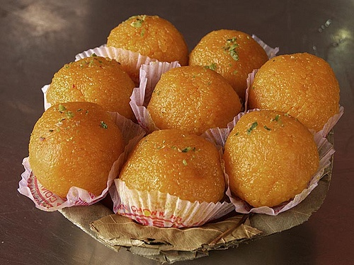 Motichoor laddu / Boondi laddu is a sweet Indian delicacy made from grilled gram flour flakes (boondis) which are sweetened, mixed with dried fruits, pressed into balls and fried in ghee. Motichur Laddos are generally used in auspiciuous / traditional occassions like weddings, engagements, births etc.  It gets the name Motichoor Laddoo (Moti means bead / pearl in Hindi) / Boondi Laddu (drops / droplets are known as Boond in Hindi).