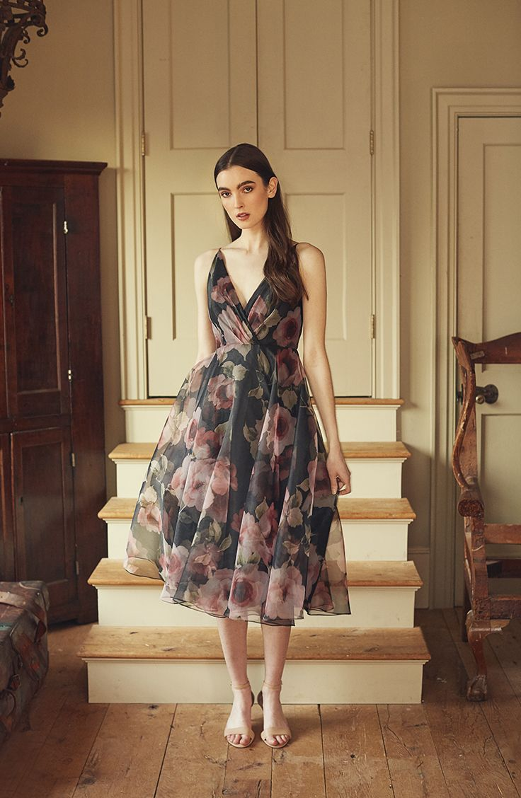 Jenny Yoo 2018 Bridesmaids, the short floral printed Sabrina dress features a surplice bodice with delicate spaghetti straps for a feminine silhouette. The taffeta circle skirt hits at midi tea length and billows out to create movement. V Neck. This dress is fully lined with a center back seam. Perfect for a cocktail event, garden, or summer wedding. Shown in Blush Multi, available in Black Multi. Photography by Stephanie Williams.